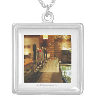Close-up of beer taps in bar 2 square pendant necklace
