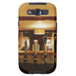 Close-up of beer taps in bar galaxy s3 covers