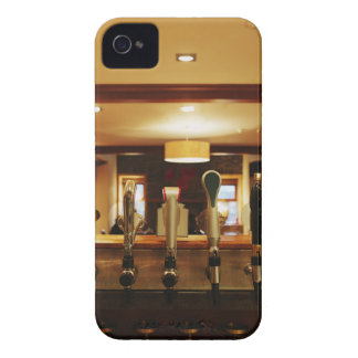 Close-up of beer taps in bar iPhone 4 cover