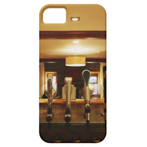 Close-up of beer taps in bar iPhone 5 cover