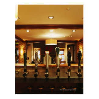 Close-up of beer taps in bar postcard
