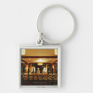Close-up of beer taps in bar Silver-Colored square keychain