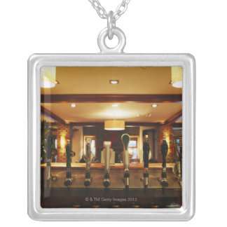 Close-up of beer taps in bar square pendant necklace