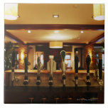 Close-up of beer taps in bar tiles