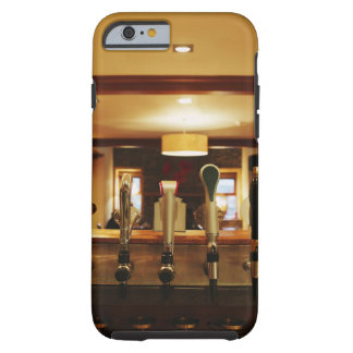 Close-up of beer taps in bar tough iPhone 6 case