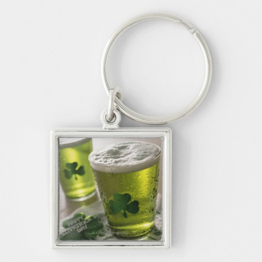 Close up of beverages with shamrocks on glass keychain