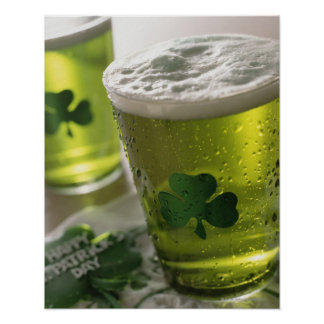 Close up of beverages with shamrocks on glass posters