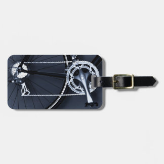 Close up of bicycle chain, pedal and gears luggage tag