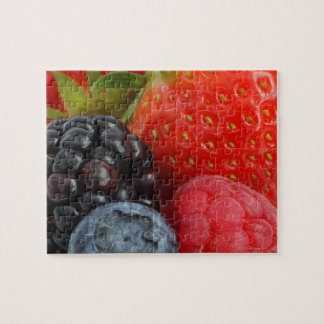 Close-up of blackberry, blueberry and jigsaw puzzle