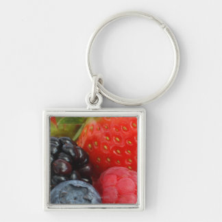 Close-up of blackberry, blueberry and keychain