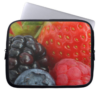 Close-up of blackberry, blueberry and laptop sleeve