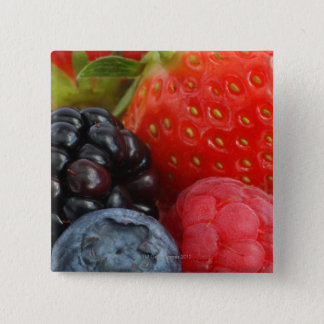 Close-up of blackberry, blueberry and pinback button