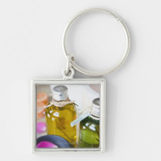 Close up of bottles with massage oils keychain