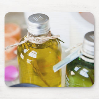 Close up of bottles with massage oils mouse pad