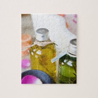 Close up of bottles with massage oils puzzle
