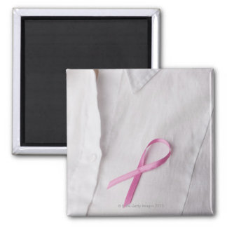 Close up of Breast Cancer Awareness Ribbon on Refrigerator Magnet