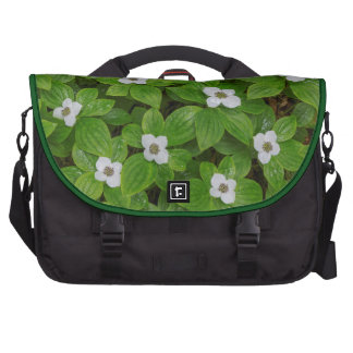 Close-up of bunchberry with white flowers commuter bag