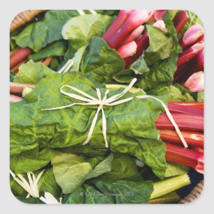 Close-up of bunches of rhubarb in basket square sticker