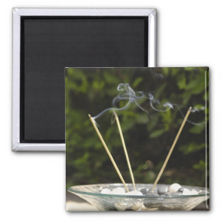 Close-up of burning incense sticks with pebbles 2 inch square magnet