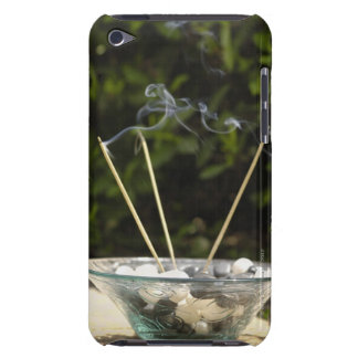 Close-up of burning incense sticks with pebbles barely there iPod case