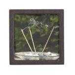 Close-up of burning incense sticks with pebbles premium keepsake box