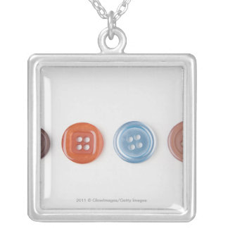 Close-up of buttons square pendant necklace