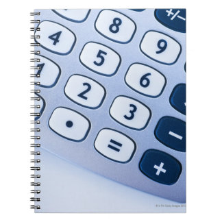 close-up of calculator buttons notebook