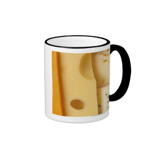 Close-up of cheese slices coffee mugs
