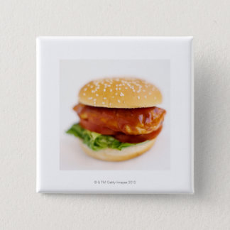Close-up of chicken burger pinback button