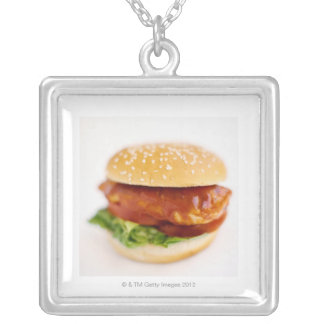 Close-up of chicken burger square pendant necklace