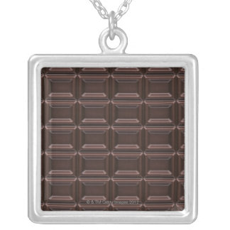 Close-up of chocolate bar silver plated necklace