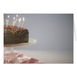 Close up of chocolate birthday cake with candles greeting card