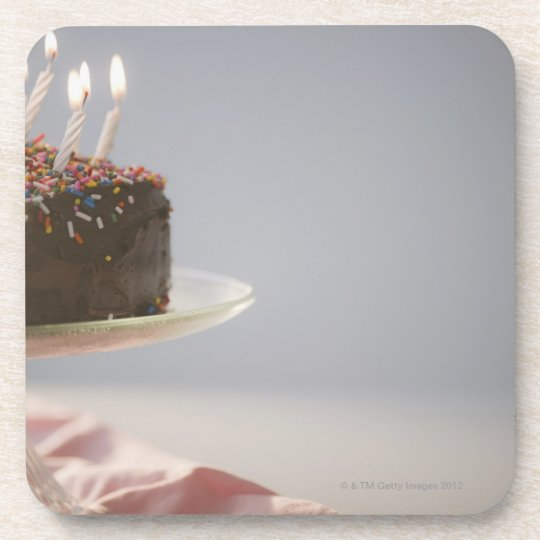 Close up of chocolate birthday cake with candles coaster