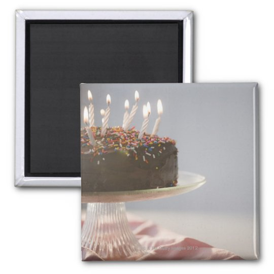 Close up of chocolate birthday cake with candles magnet
