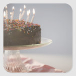 Close up of chocolate birthday cake with candles square sticker