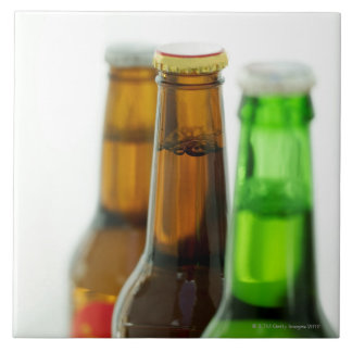 close-up of colored bottles of beer large square tile