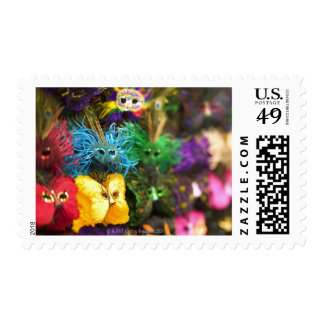Close-up of colorful miniature masks stamps