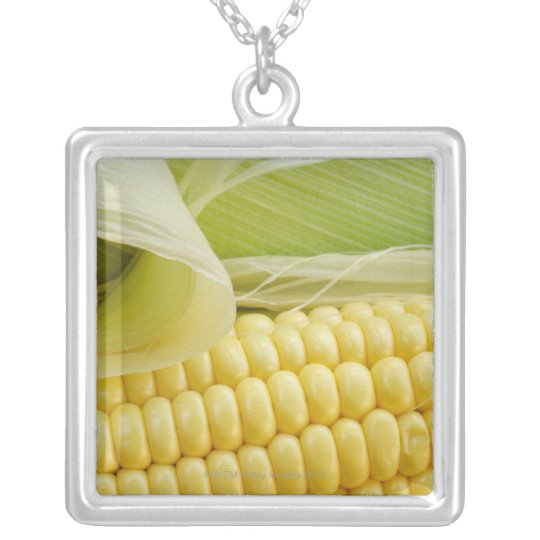 Close up of corn silver plated necklace