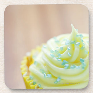 Close up of cup cake showing decoration drink coaster