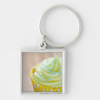 Close up of cup cake showing decoration keychain