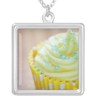 Close up of cup cake showing decoration silver plated necklace