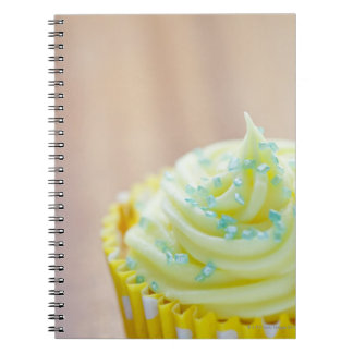Close up of cup cake showing decoration spiral notebook