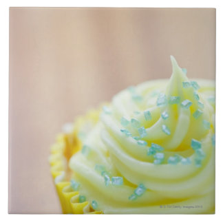 Close up of cup cake showing decoration tile