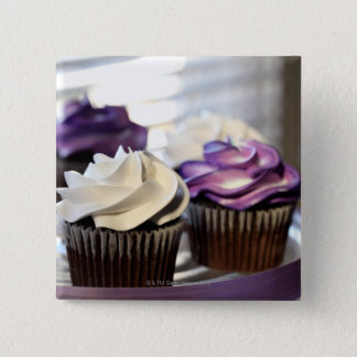 Close-up of cupcakes with selective focus on button