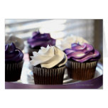 Close-up of cupcakes with selective focus on greeting cards
