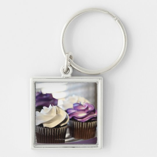 Close-up of cupcakes with selective focus on keychain