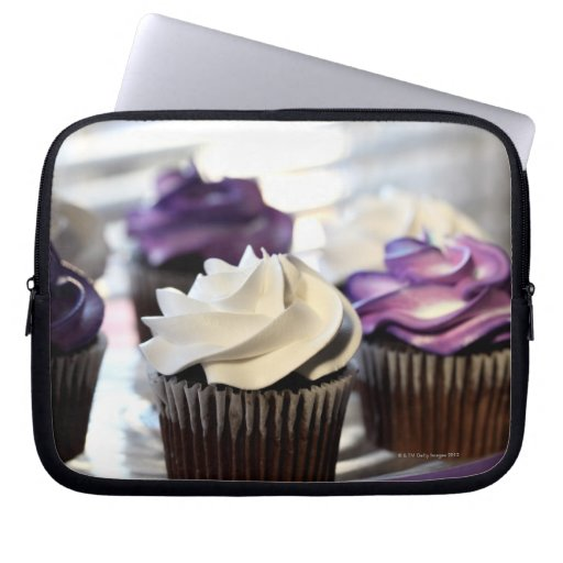 Close-up of cupcakes with selective focus on computer sleeve