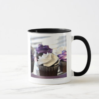 Close-up of cupcakes with selective focus on mug