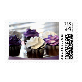 Close-up of cupcakes with selective focus on postage stamps