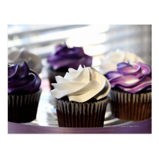 Close-up of cupcakes with selective focus on post card